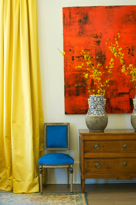 view full size Stunning yellow and blue living room with yellow curtains