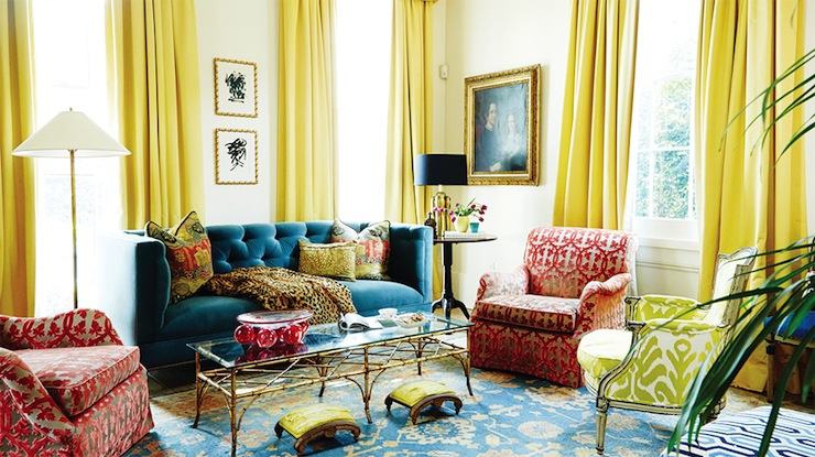 Chic Living Room With Yellow Curtains Framing Blue Velvet Tufted Sofa  Accented With Cheetah Print Throw Blanket Flanked By Antique Brass Floor  Lamp And ...