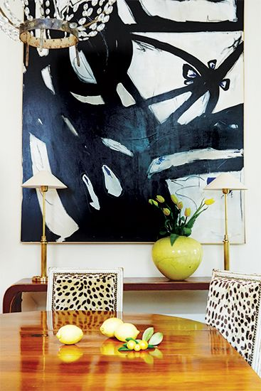 Chic Dining Room With Black And White Abstract Art Over Waterfall Console Table Filled Antique Brass Buffet Lamps