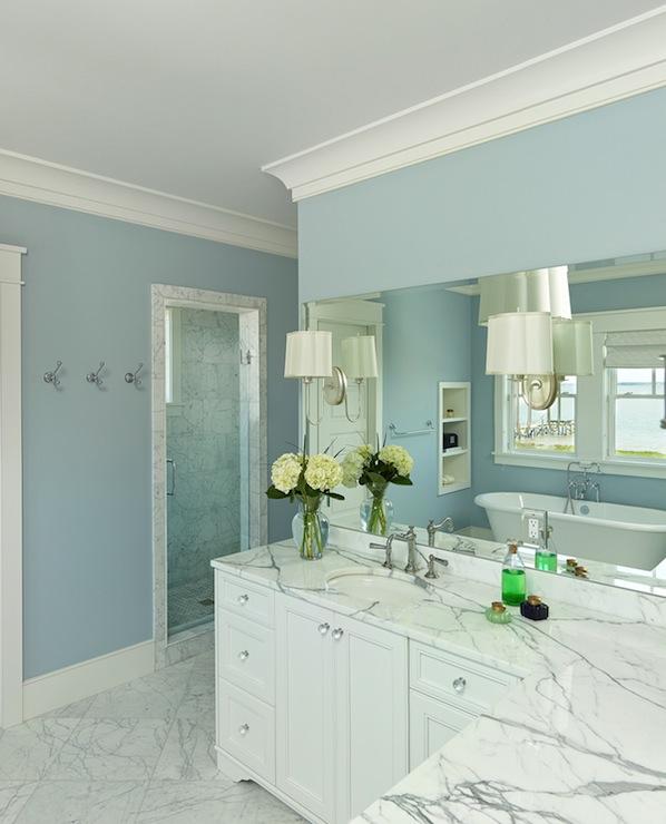Stunning bathroom with blue walls and crisp white trim. L Shaped Bathroom Vanity Design Ideas