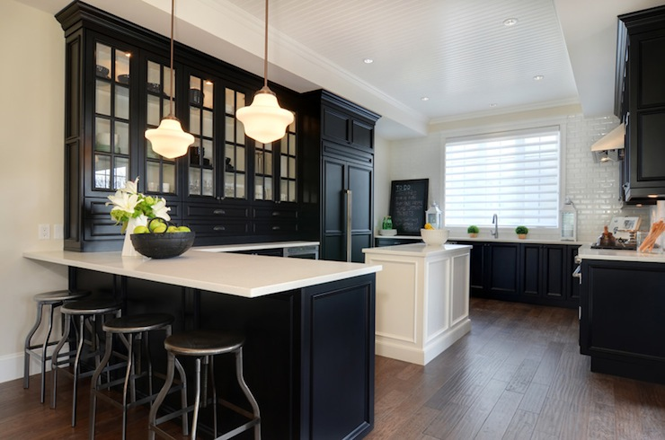 Black kitchen cabinets with white countertops for Images of black kitchen cabinets