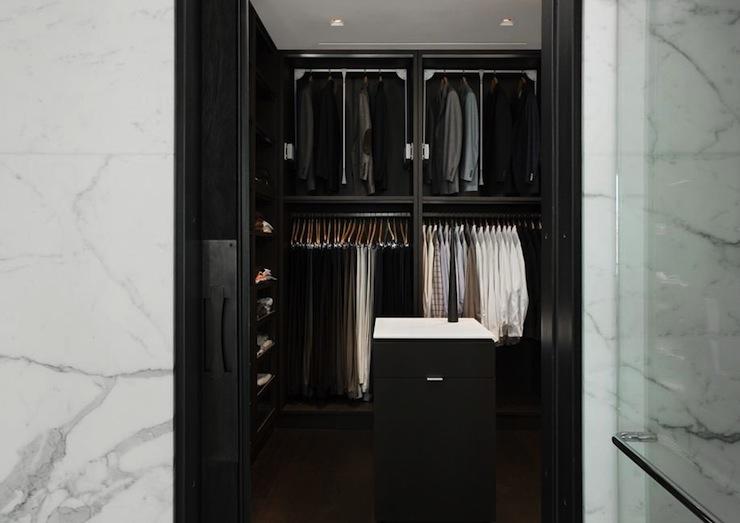 Attractive Mensu0027 Closet Features Black Built In Cabinets, Black Closet Island And Black  Pocket Door.