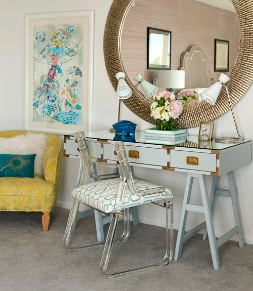 Lara Spencer Master Bedroom Features Large Mirror Over Light Blue Campaign Desk Paired With Lucite Chairs