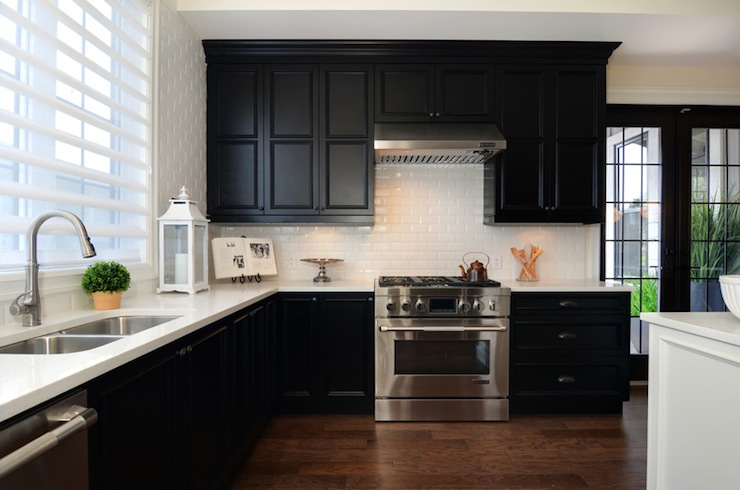 Black and white kitchen with black cabinets with white quartz