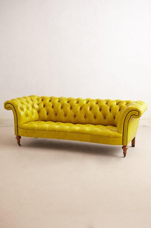 Citrine yellow leather button tufted sofa for Yellow leather sofa bed