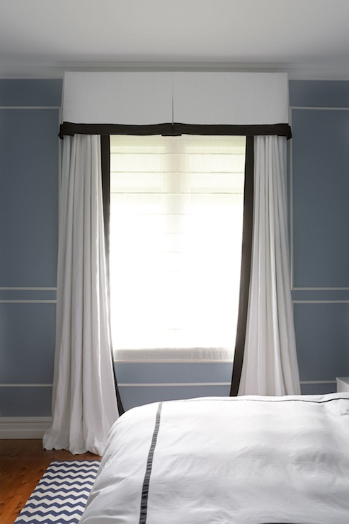 Bedroom Features Blue Walls With White Trim Accented Black And Valance Curtains