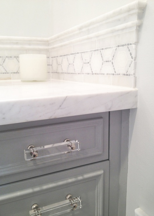 Superieur Brilliant Bathroom Features Gray Vanity Accented With Lucite Pulls Paired  With White Marble Countertop And White Marble Backsplash Accented With  Mosaic ...