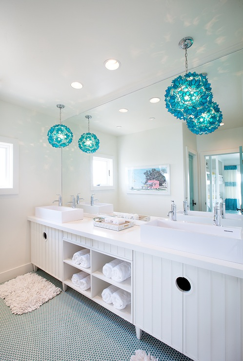 Stunning Kidsu0027 Bathroom With Turquoise Blue Capiz Pendants Over His And Her  Sinks Over White Recycled Bath Mats Over Turquoise Blue Penny Tiled Floor.