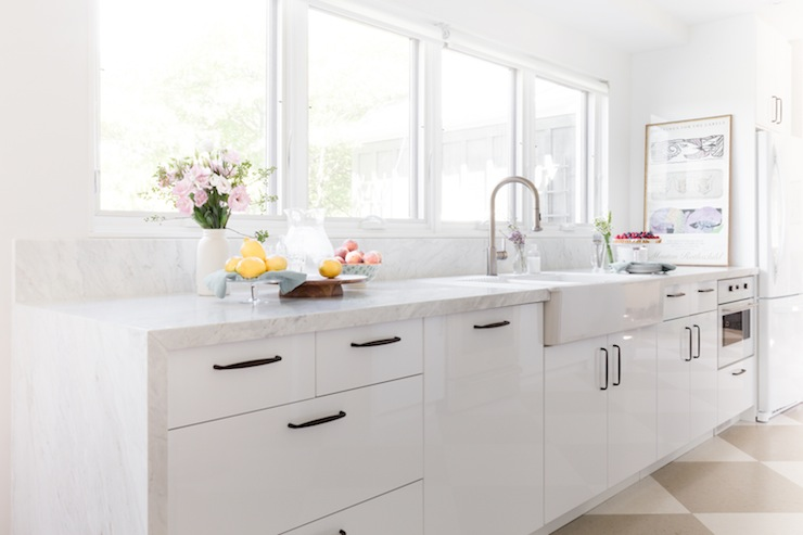 Filled Kitchen Features Bank Of Windows Over White Lacquered Cabinets