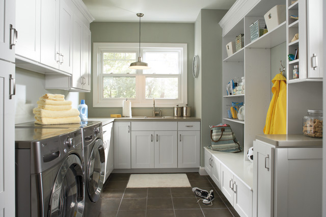 Wonderful Mudroom Laundry Room Combo Features White Cabinets On Gray Walls Paired  With Gray Countertops.