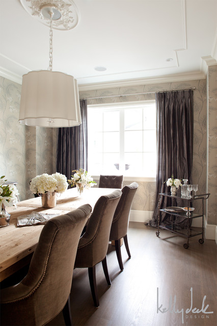 Elegant Dining Room With A Wooden Dining Table Lined With Brown Velvet Tufted Dining Chairs