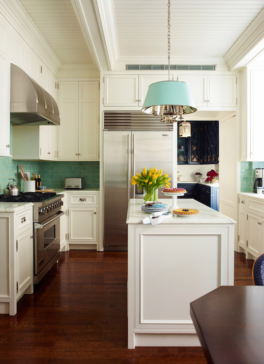 Stunning U Shaped Kitchen With Ivory Ceiling Height Cabinetry Paired With Polished Nickel Hardware And Marble Counters