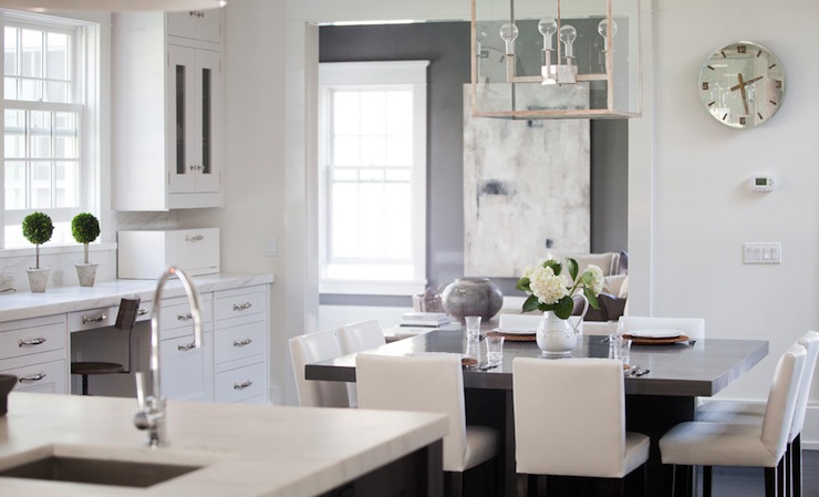 Eat In Kitchen Features Nickel And Glass Lantern Over Gray Square Dining  Table Seating Eight White Parsons Dining Chairs.
