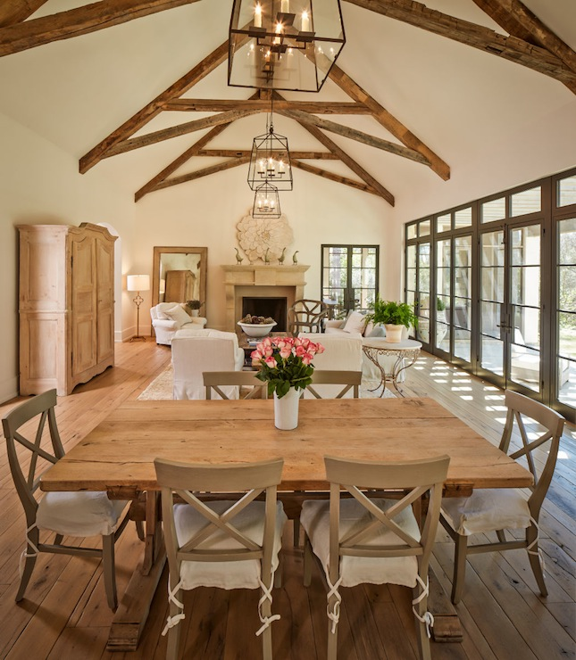 Table Surrounded By Taupe X back Dining Chairs Over Rustic Wood Floors