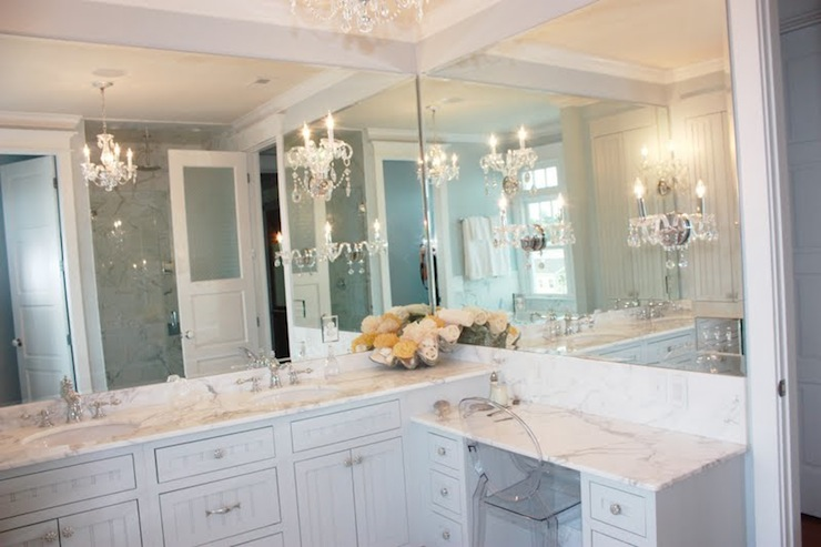 Luxurious Bathroom With White Beadboard Vanity Cabinets And Drop Down Makeup  Vanity.