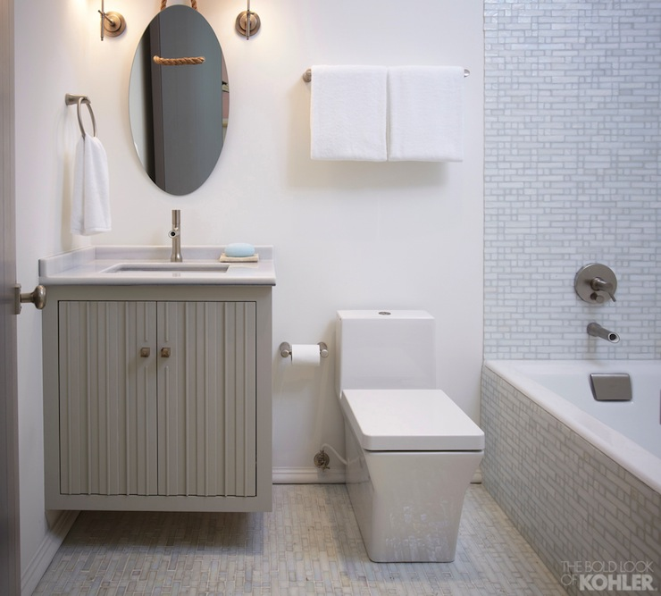 Contemporary bathroom with a gray floating vanity paired with a marble  counter  undermount sink and Kohler Toobi Faucet. Interior design inspiration photos by Kohler