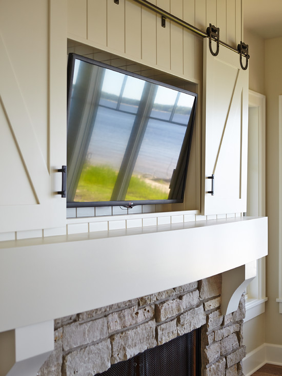 Hidden tv over fireplace design ideas for Hiding a tv in the living room