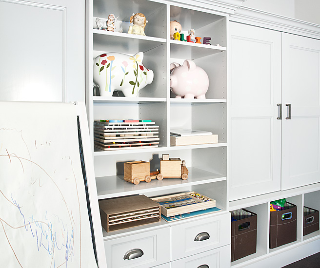 Playroom With Wall Of Cabinets Featuring Open Cubbies Used To Display Books  And Toys.