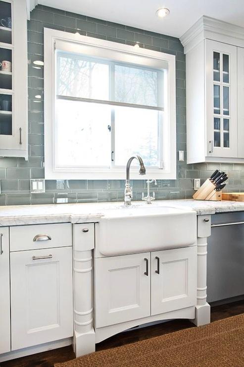 with white marble countertops and gray glass subway tiled backsplash