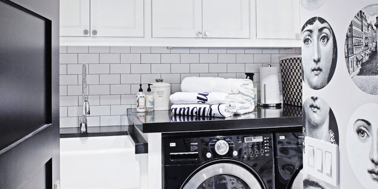 Chic Black And White Laundry Room With Fornasetti Wallpaper Paired Simple Cabinets Featuring Modern Nickel Hardware