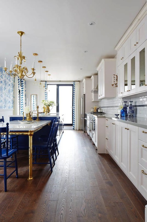 Show stopping white and blue kitchen with walls, ceiling and trim