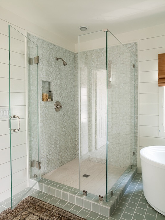 Stunning Bathroom With Corner Shower Featuring Frameless Glass Surround Blue Gray Mosaic Tiled Walls And Nook Alongside A Simple White Tile Floor