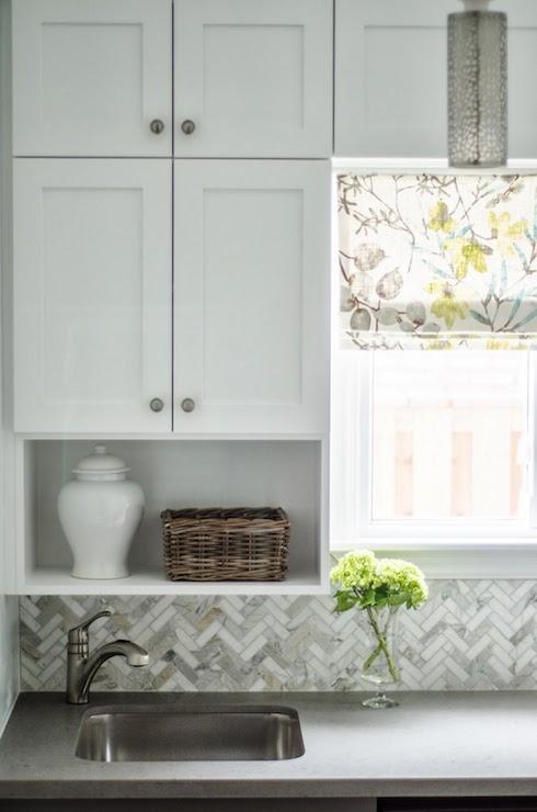 herringbone tile backsplash paired with gray silestone countertops