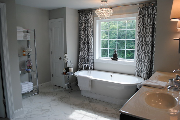 Gorgeous bathroom features Robert Abbey Bling Chandelier over freestanding tub placed in front of window covered in white and gray trellis curtains. Trellis Curtains   Contemporary   bathroom   Karen Viscito Interiors