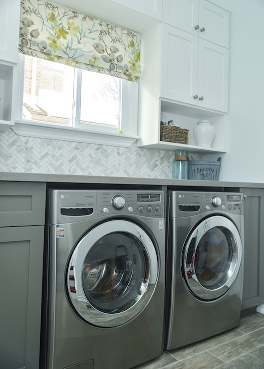 marble herringbone tiles transitional laundry room