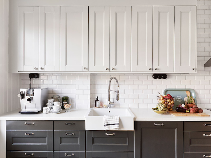 White upper cabinets dark lower cabinets transitional kitchen