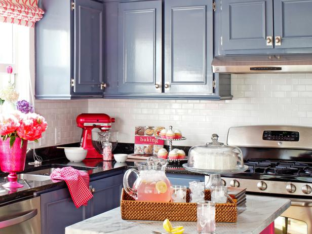 Pink And Blue Kitchen Features High Gloss Steel Lacquered Cabinets Accented With Trim Mimicking Raised Panel Doors Paired Polished Black Granite