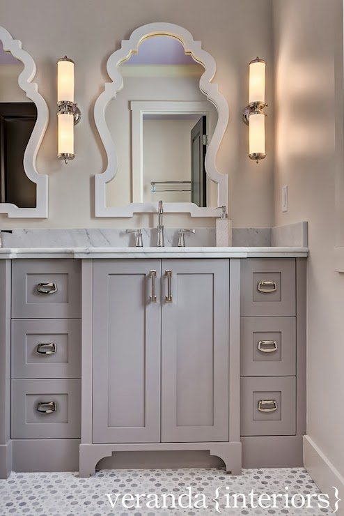 grey bathroom features jonathan adler queen anne mirrors on light gray