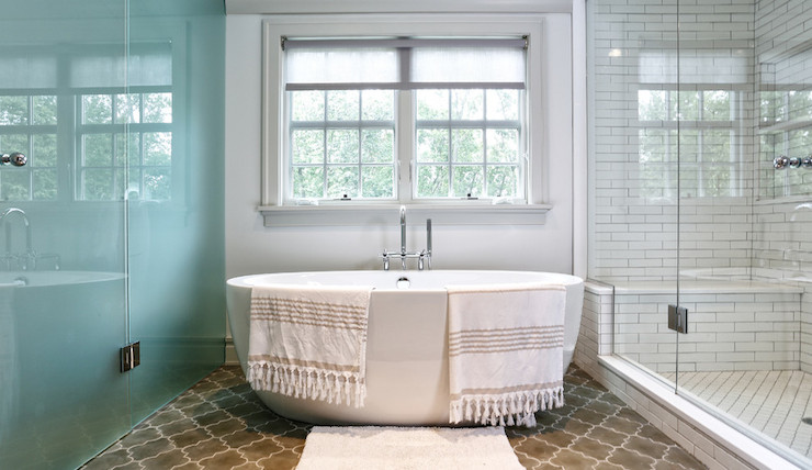 Amazing Bathroom Features Freestanding Bathtub Paired With Floor Mounted Tub Filler Over Brown Moroccan Tiled Floor Flanked By Water Closet With Frosted