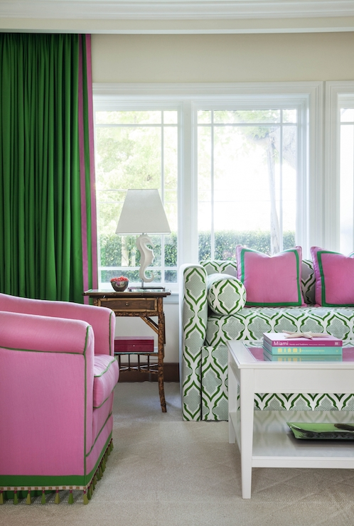 Pink And Green Living Room With Blue Patterned Daybed Accented Matching Bolster Pillows Flanked By Bamboo End