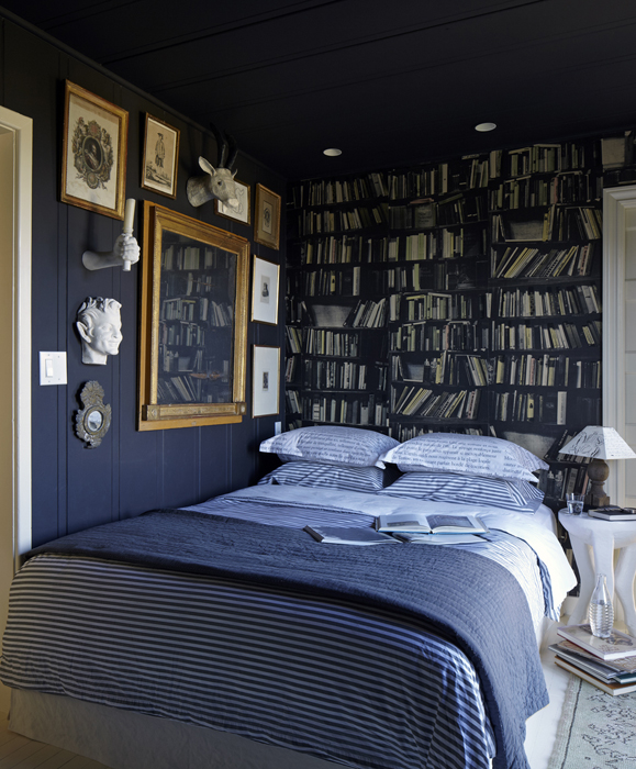 eclectic bedroom features navy blue ceiling over arteriors lola table