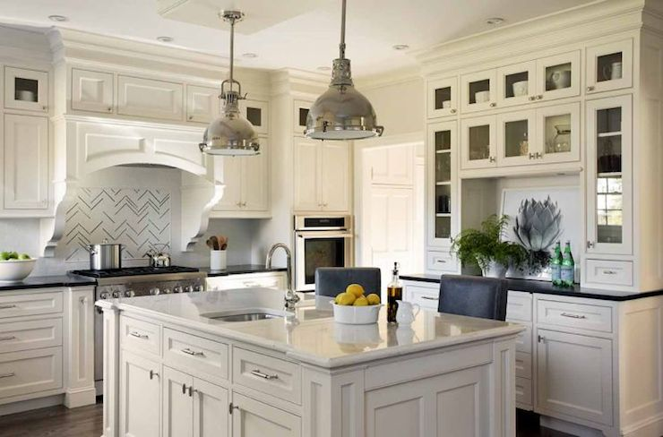Gorgeous Kitchen With White Cabinets Paired With Black Countertops As Well  As Built In Hutch With Glass Doors Paired With Built In Buffet Cabinet.