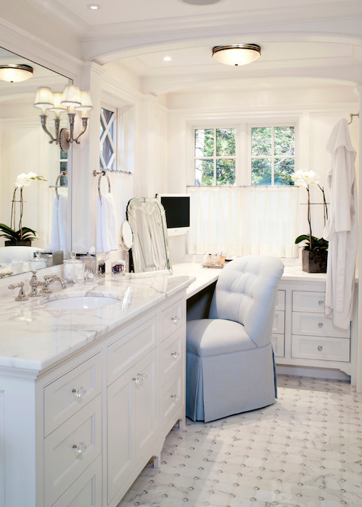 Master Bathroom Features White Washstand Accented With Crystal Knobs Paired Marble Countertops And Inset Mirror Over Tiled Floor