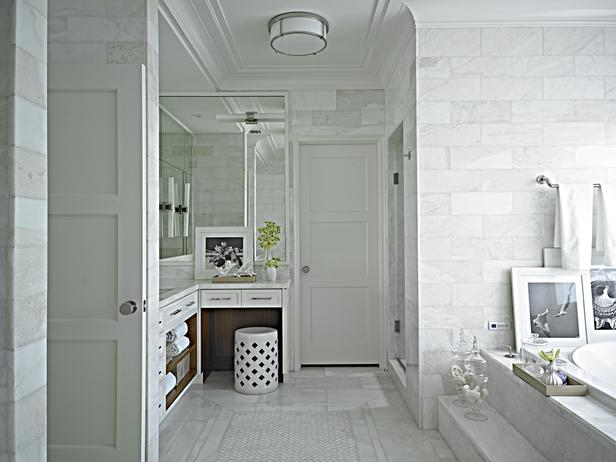 Amazing bathroom with L shaped vanity paired accented with open shelving  and topped with white marble countertop  ceiling height marble backsplash  and. Dual L Shaped Bathroom Vanity Design Ideas