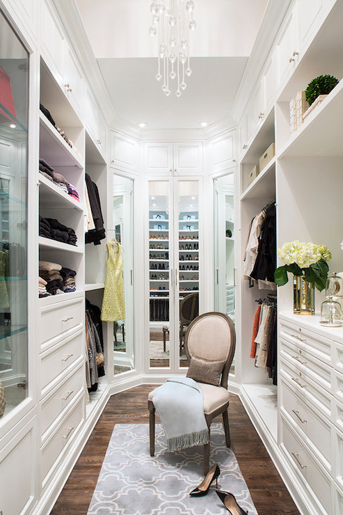 Exquisite Closet Features Floor To Ceiling Wardrobe Cabinets Accented With  Mirrored Doors.