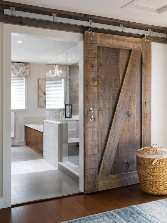 Contemporary bathroom with glass walk in shower beside wood paneled
