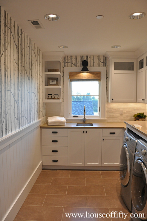 laundry room with branch wallpaper and beadboard walls