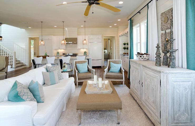 Beach Cottage Living Room Features Ceiling Fan Over White Slipcovered Sofa With Ruffled Skirt Accented Gray And Turquoise Pillows Paired Burlap