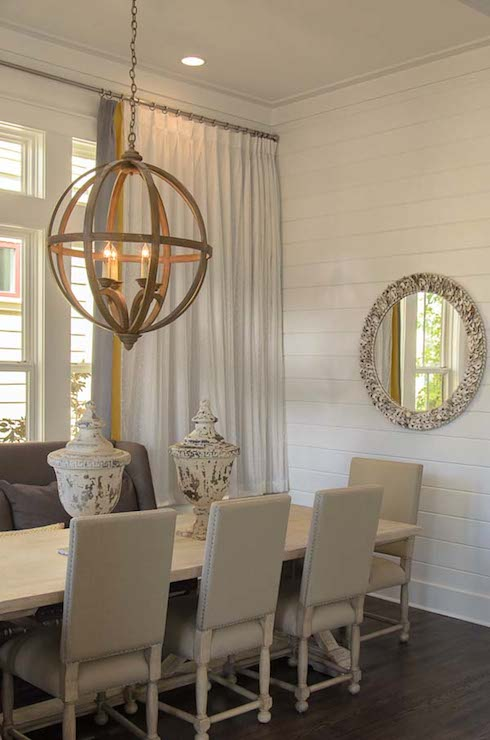 beach cottage dining room features spherical wood chandelier currey co