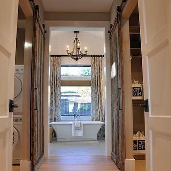 'Laundry Room with Barn Door' from the web at 'https://cdn.decorpad.com/photos/2013/12/04/m_b8b386e0843a.jpg'