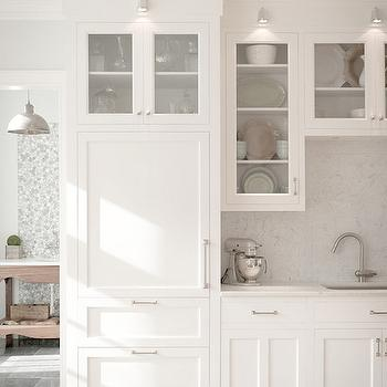 Hidden Refrigerator View Full Size. Amazing Monochromatic Kitchen With  White Cabinetry Featuring Nickel Hardware Alongside Honed Carrara Marble  Counters ...