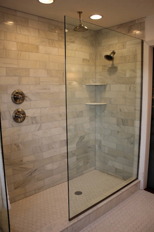 shower head corner shower shelves and white hex tile shower floor
