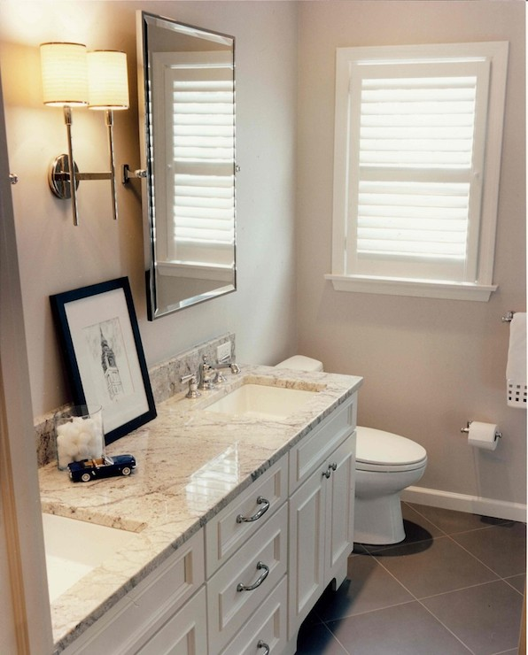 fabulous bathroom features light gray walls framing rectangular pivot mirrors flanking polished nickel double sconce over white double washstand with white