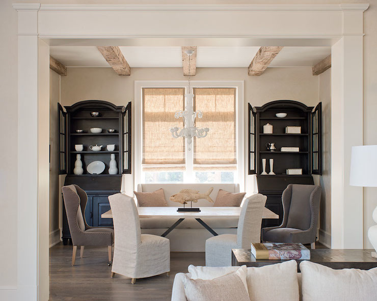 Gorgeous Dining Room With Black China Cabinets Flanking Large Windows Dressed In Burlap Roman Shades