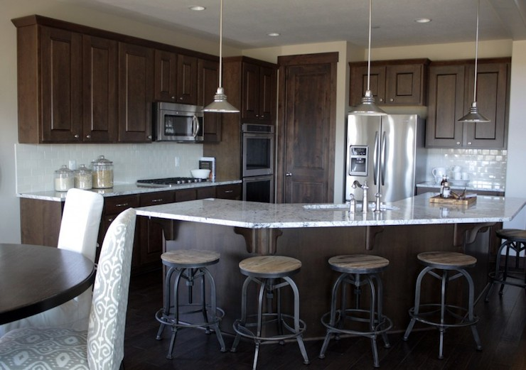 Dark brown cabinets with gray countertops home for Brown kitchen cabinets with black granite
