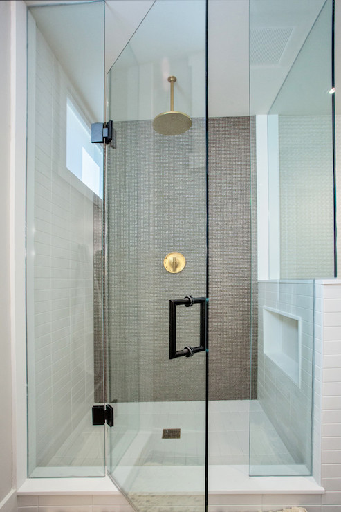 gold rain shower head. Exquisite bathroom features glass walk in shower filled with gray studded  tile surround as well brass head Gold Rain Shower Head Contemporary Madison Taylor